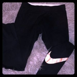 Nike tights with rose gold swoosh